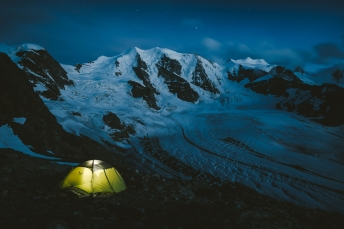 Camping in fron tof the Piz Palue in the Bernina Alps Switzerland.
