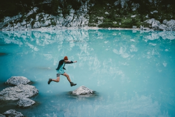 Jumping around alpine lakes in the Dolomites, Italy.